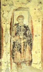 Il nobile franco ha la spada circondata da un nastro, segno che è un periodo di pace
